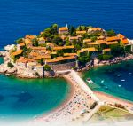The island of Saint Stephen (Sveti Stefan) is an island-hotel and deluxe resort, located few kilometers from a tourist center of Montenegro, Budva. The view opening from the top sightseeing platform overlooking Sveti Stefan is the most remarkable and widely promoted on the post cards for tourists.