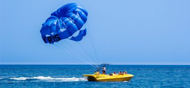 Parasailing - flight on a parachute behind a boat